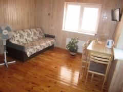Apartamentinis kambarys su patogumais